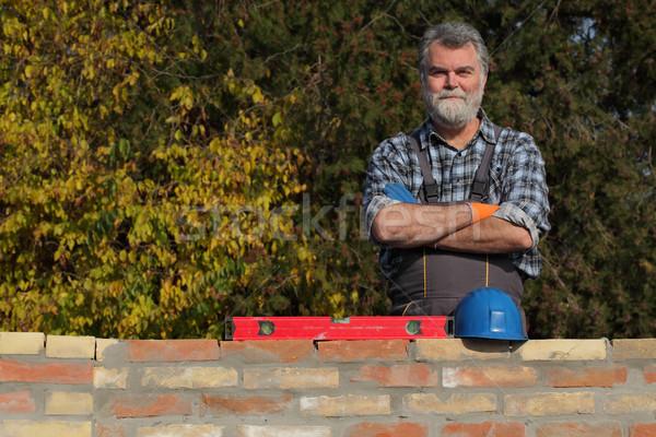 Worker examining brick wall Stock photo © simazoran