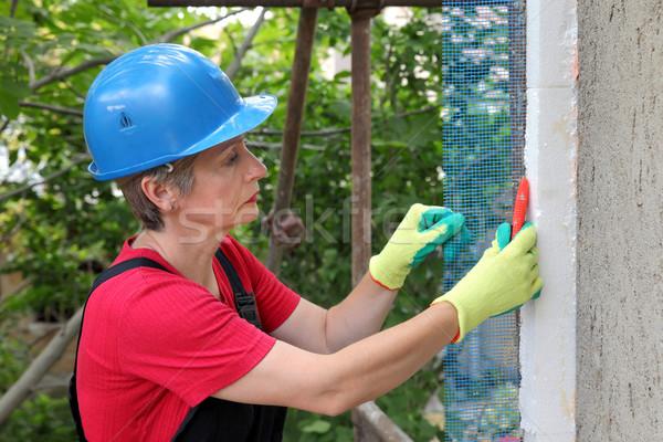Construction site, styrofoam insulation mesh cutting Stock photo © simazoran