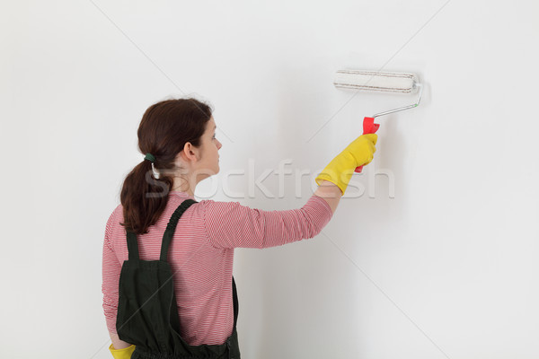 Female worker painting wall in a room Stock photo © simazoran