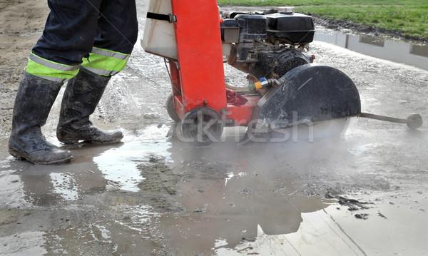Construction site, asphalt cutting tool at road construction sit Stock photo © simazoran