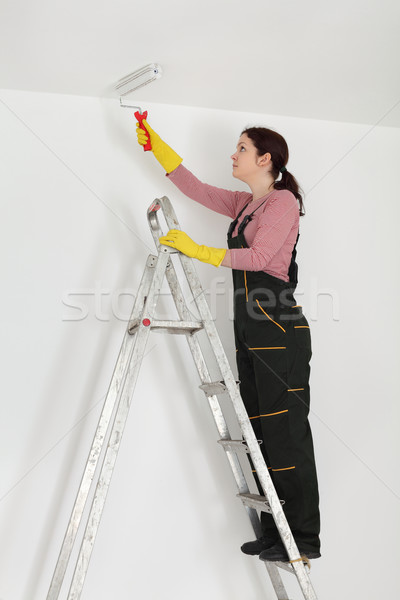 Young worker paint ceiling in a room Stock photo © simazoran