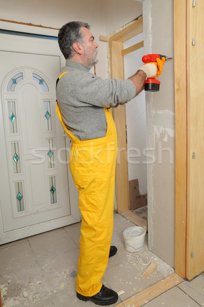 Construction site, worker installing gypsum board Stock photo © simazoran
