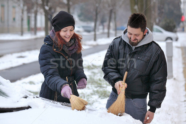 Automotive, couple remove snow from a car Stock photo © simazoran