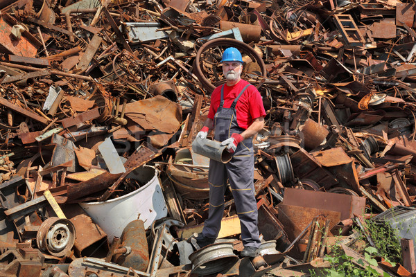 Recycling industry, worker stand at heap of old metal Stock photo © simazoran