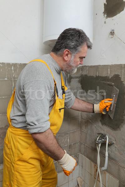 Home renovation, mason fixing wall Stock photo © simazoran