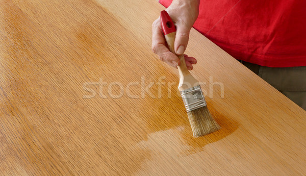 Wooden plank varnishing, workers hand using tool Stock photo © simazoran