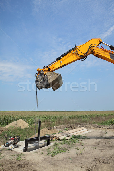 Agriculture, irrigation gate at channel construction site Stock photo © simazoran
