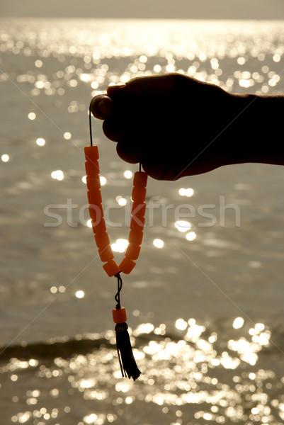 ロザリオ 手 海 日没 オレンジ 海 ストックフォト © simazoran