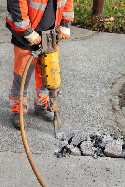 Asphalt demolishing, worker and jackhammer Stock photo © simazoran