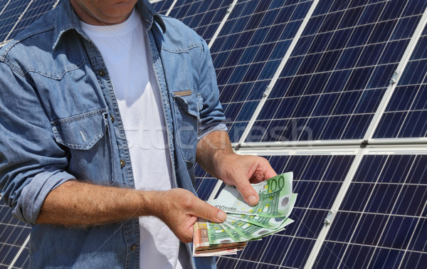 Solar energy panels concept with Euro money Stock photo © simazoran