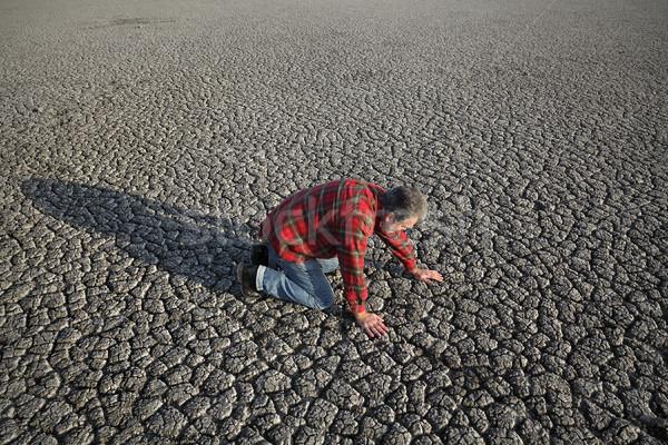 Homme sécheresse désespérée prière sécher Photo stock © simazoran