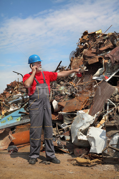 Recycling industry, worker and heap of old metal Stock photo © simazoran