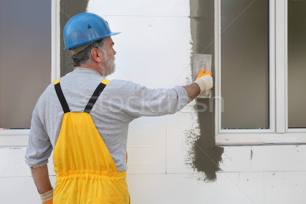 House renovation, polystyrene wall insulation Stock photo © simazoran