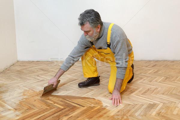 Home renovation, oak parquet varnishing finish Stock photo © simazoran