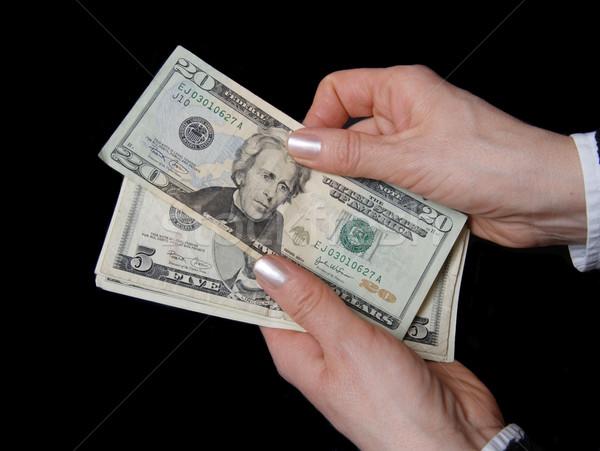 Pénz nő kezek dollár bankjegy közelkép Stock fotó © simazoran