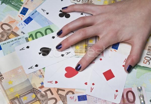 Hazárdjáték halom Euro kártyák szerencsejátékos kéz Stock fotó © simazoran