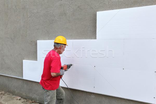 Bouwplaats isolatie boren anker werknemer vel Stockfoto © simazoran