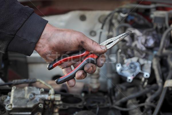 Car mechanic hold pliers tool in hand Stock photo © simazoran