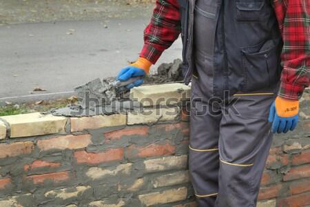 Construction site, worker and jackhammer tool Stock photo © simazoran