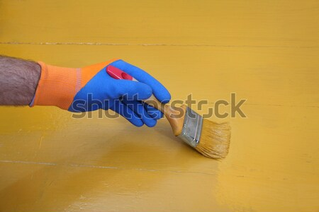 Worker sanding wooden plank, closeup of hand Stock photo © simazoran