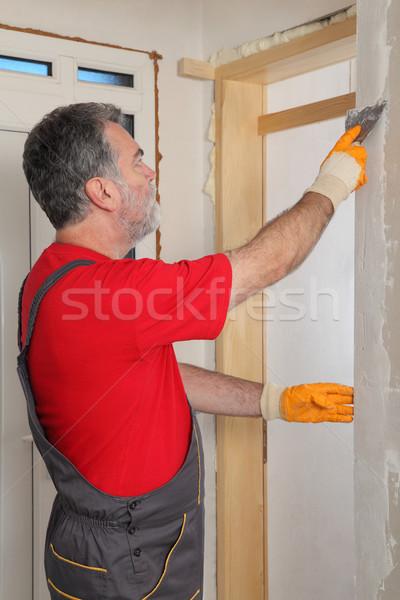 építkezés munkás installál gipsz tábla tapasz Stock fotó © simazoran
