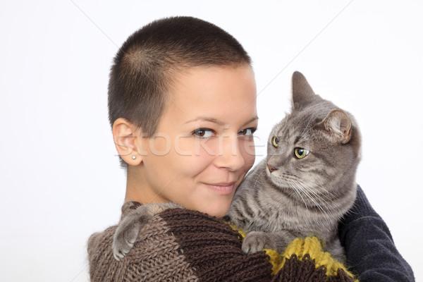 Nina gato jóvenes mujer sonriente mantener gris Foto stock © simazoran