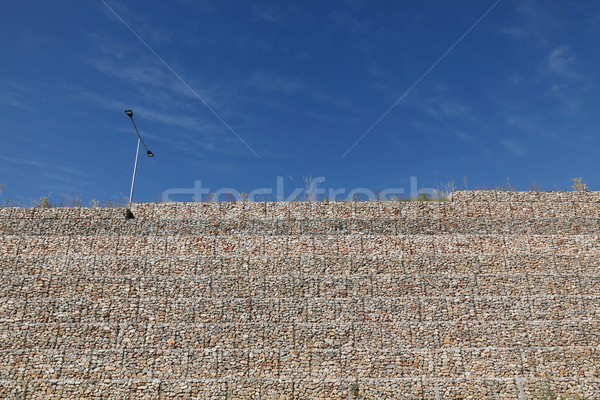 Road embankment of gravel reinforced with steel mesh Stock photo © simazoran