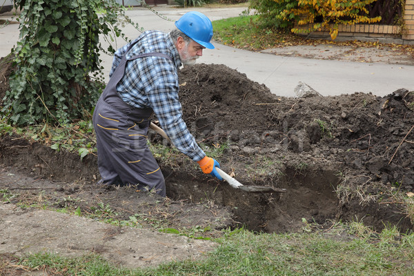 окоп лопатой работник строительная площадка трубопровод Сток-фото © simazoran