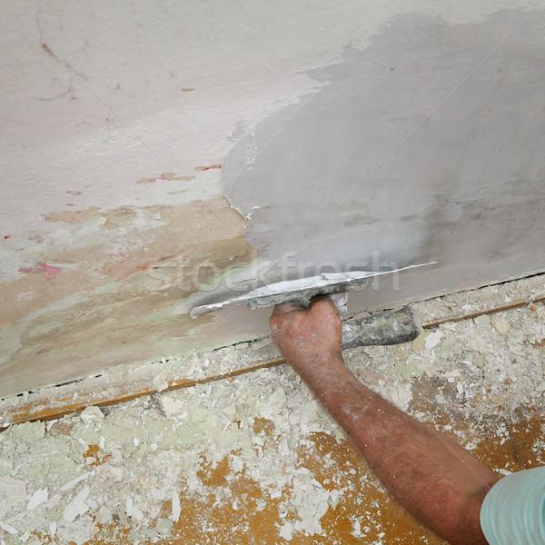 Worker fix damaged wall Stock photo © simazoran