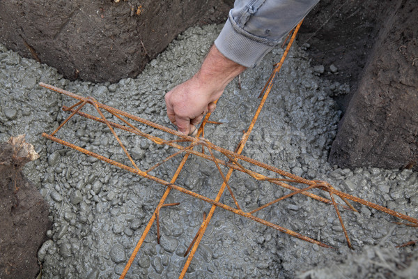 Wall foundation making, worker hand concrete and reinforcement Stock photo © simazoran