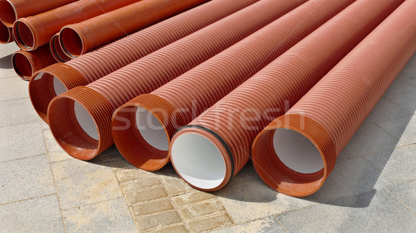 Construction site, heap of PVC tubes Stock photo © simazoran