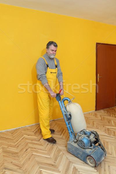 Home renovation, worker sanding parquet Stock photo © simazoran