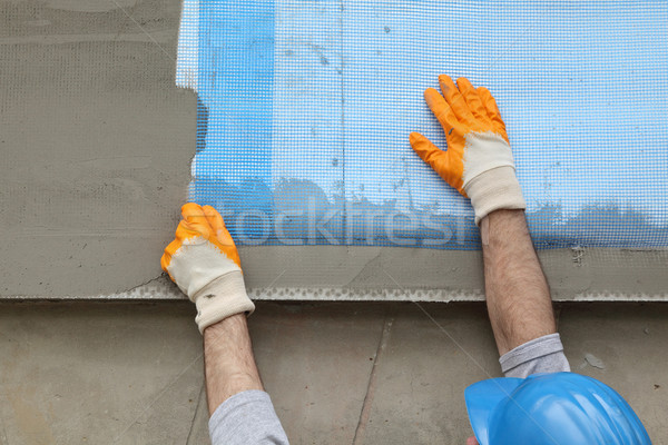 Styrofoam facade insulation, installing mesh Stock photo © simazoran
