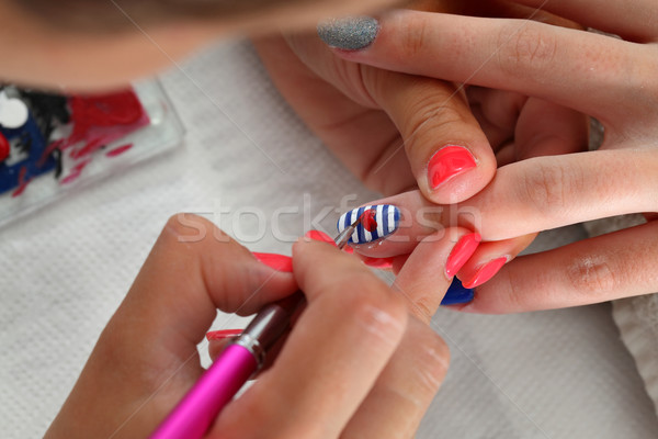 Beauty treatment of fingernails, manicure Stock photo © simazoran