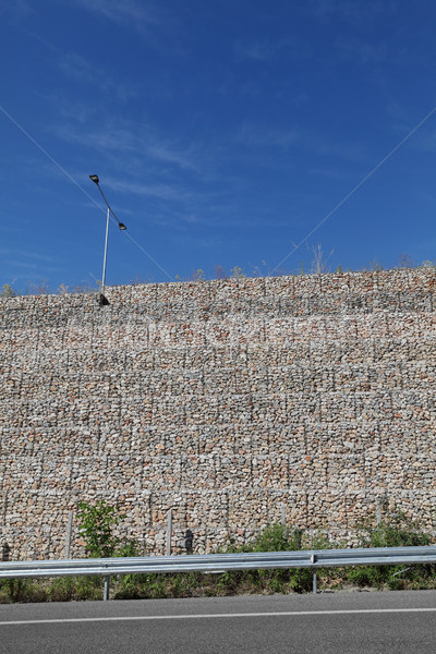 Road embankment of gravel reinforced with steel mesh Stock photo © simazoran