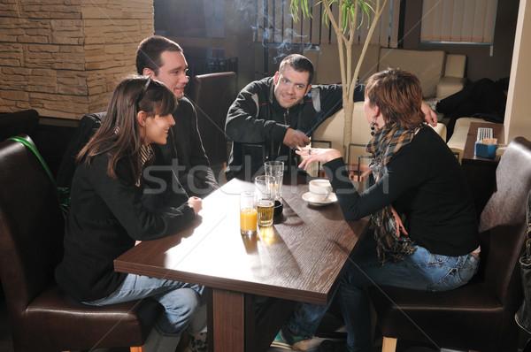 Kávézó fiatalok ül beszél lány férfi Stock fotó © simazoran