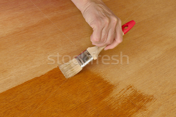 Wooden plank varnishing Stock photo © simazoran