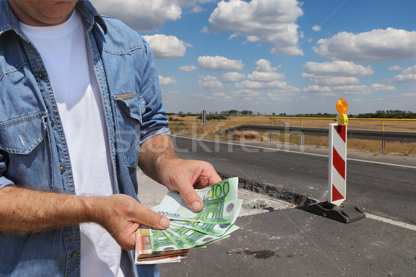 Highway or road in reconstruction, worker holding money Stock photo © simazoran