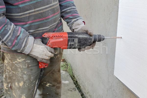 Home lavoratore perforazione foglio isolamento Foto d'archivio © simazoran