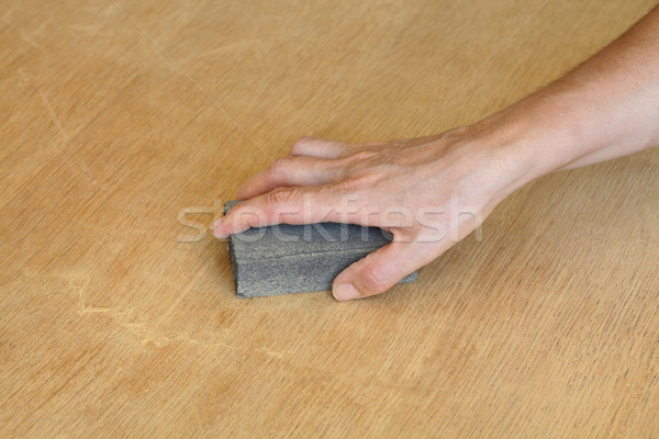 Worker sanding wooden plank Stock photo © simazoran