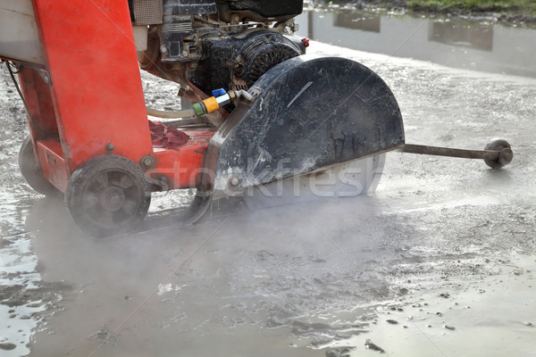 Construction site, asphalt cutting tool at road construction sit Stock photo © simazoran