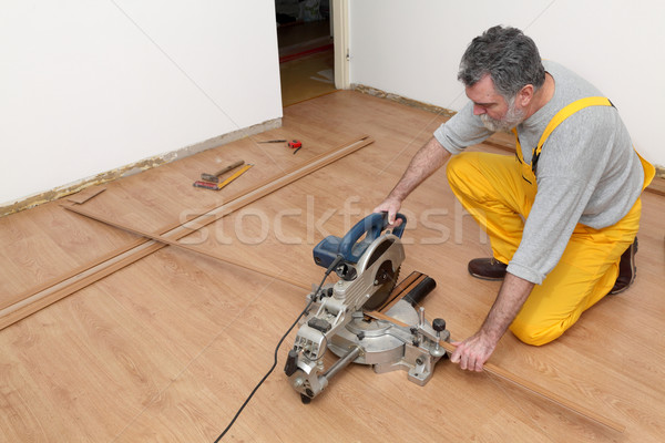 Laminate flooring of room, batten cuting Stock photo © simazoran
