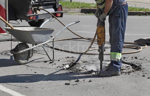 Asphalte travailleur construction de routes construction travaux Photo stock © simazoran