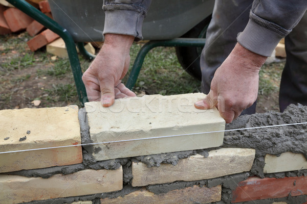 Stock photo: Worker building brick wall