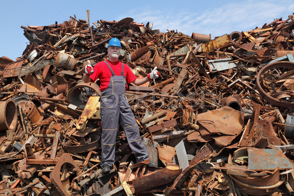 Recycling industry, worker gesture at heap of old metal Stock photo © simazoran