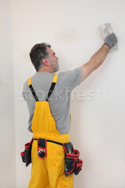 Trabajador pared habitación yeso casa Foto stock © simazoran
