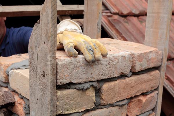каменщик работу рук дымоход здании Сток-фото © simazoran