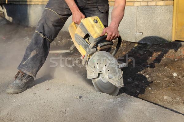 Construction site, worker and tool Stock photo © simazoran