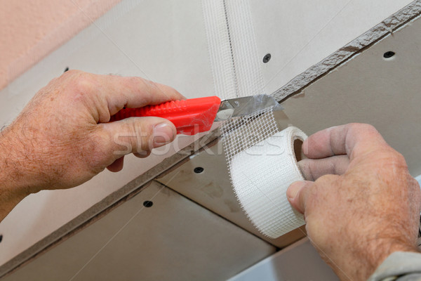 Fibra cortar trabalhador gipsita Foto stock © simazoran