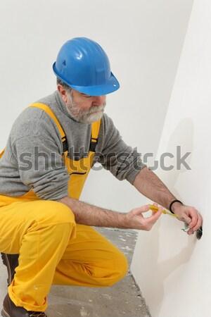 Bouwplaats isolatie lijm werknemer schuim Stockfoto © simazoran